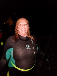 A jubilant Nic Goddard celebrates after completing the night swim. NO F41 Nic swimmer
