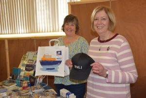 Judy Unkles and Eunice Salmon busy selling RNLI merchandise
