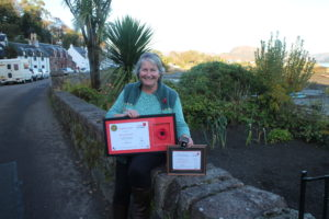 Morag Mackenzie with her certificate from Poppy Scotland. NO F45 Morag Mackenzie