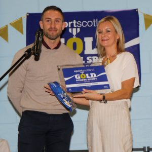 Graham Lindsay of Sportscotland hands over the award to teacher Louise Morrison. NO-F49-Laxdale-Gold-Award-Nov-2019-Graham-Lindsay-and-Lorraine-Morrison.jpg
