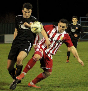 Fort's Gabriel Hastings tackles Andrew Greig (Formartine) Photograph: Ian Rennie. NO F03 FORMARTINE V FORT FC 01