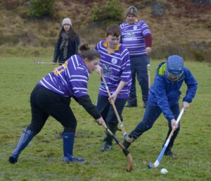 More action from some of the younger players in the traditional New Year Glenfinnan Shinty match. Photograph: Iain Ferguson, alba.photos NO F03 Glenfinnan shinty 03