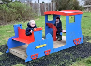 Charlotte O'Hanlon sits on the toy train which is being driven by Callan McKay.