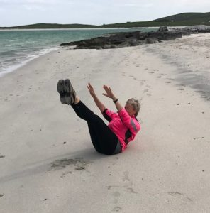 Demonstrating 'Teaser' from the Joseph Pilates Classical Series on the beach.
