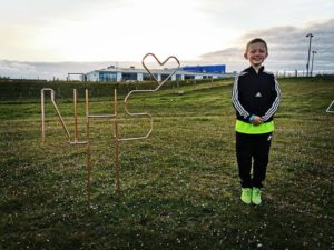Watch Commander MacGillivray's son, Peter, seen here with a sign showing support for the NHS, was one of the youngsters involved with the fire safety video. NO F23 Danielle MacGillivray son peter with nhs sign