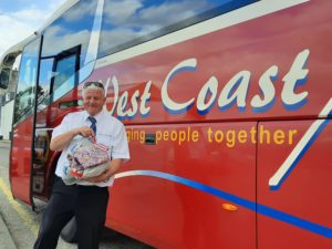 John Brown from West Coast Motors collected a parcel of scrubs on Saturday.