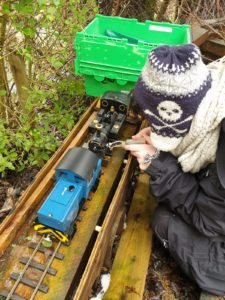 A youngster on a previous visit enjoys having fun with the model railway. NO F27 flash flood 11