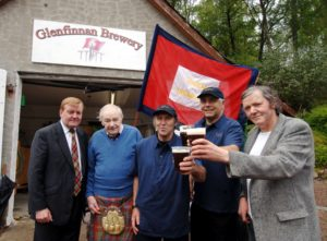Raising the standard in May, 2017, along with a pint of Standard, are Glenfinnan Brewery founders, from right, the late Donald-John Robertson, David Leckie and John Fish, and who welcomed local MP, the late Charles Kennedy, far left, and Glenfinnan Gathering organiser, the late Ronnie McKellaig, second left, to the official opening of their new venture. PICTURE IAIN FERGUSON, THE WRITE IMAGE NO F29 archive glenfinnan brewery 01