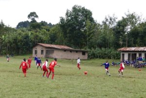 The young players sporting their Point FC strips have some fun with new footballs. NO F36 Tanzania FC 02