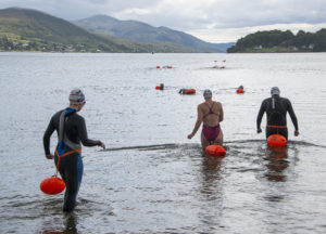 The swimmers take to the water from Caol foreshore on Friday. Photograph: Iain Ferguson, alba.photos NO F36 Corpach swim 03