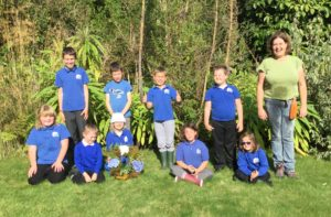 Gigha Primary School's pupils worked with Bryony White, head gardener at Achamore Gardens, to create a plastic-free, biodegradable wreath for the 80th anniversary ceremony.