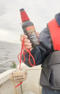 The bottle of brown ale which was sunk over the wreck site using a stone bearing the name of the merchant seamen lost.
