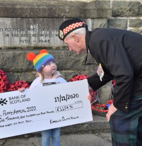 Emelie Willis says a few words to Richard Cameron, Campbeltown's area convenor for Poppyscotland.