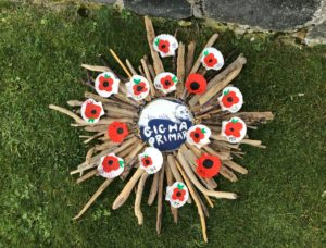 The wreath was made from driftwood and scallop shells with poppies painted on them.