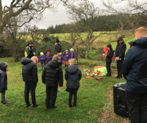 Children and staff bow their heads during the minute's silence.
