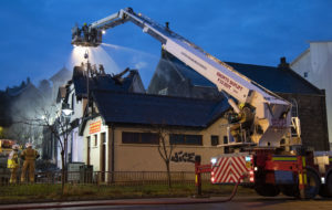 FORT WILLIAM FIRE A turntable ladder pours water into the burnt out roof of the Pier Head Chipshop, adjoining Barbers and Beauty Salon in Fort William's West End. Photograph: Iain Ferguson, The Write Image. NO F50 FORT WILLIAM FIRE 03