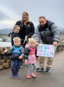 Dorothy Ralston, Fergus Walker and their children Maida, William and Eilidh with their supportive sign reading: 'Well done, girls!'