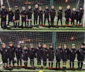 The two 2013 teams with their new jackets courtesy of the late MC Croll's family.