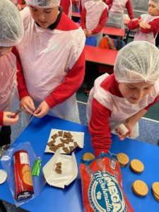 The children put together s'mores kits using marshmallows, biscuits and chocolate.