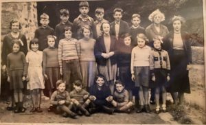 Do you recognise any faces in this school photograph?
