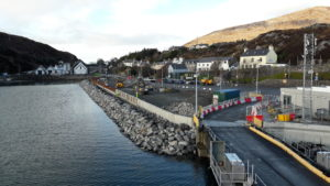 West view of west wall: ongoing construction of rock armour and marshalling area. NO F08 Harris pier 02