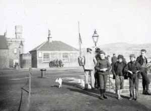 The weigh house was a gathering point for old friends, like those seem sitting on a bench in this photograph.