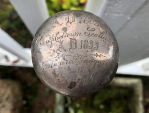 A cane belonging to Edward McTaggart, inscribed with his name, the words 'Campbeltown' and 'Scotland' and the dates 1603 and 1833.
