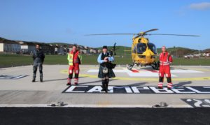 From left: Scottish Ambulance Service pilot Brett Hesketh, operational paramedic Jason Mortimer, piper Julie Blue, and operational paramedic Jim Henderson.