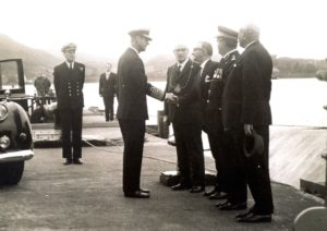 Prince Philip greeting staff and local figures at Campbeltown's oil fuel depot. Thomas Mason, who supplied the photograph and was jetty supervisor, can be seen in the background, to the left of the prince.
