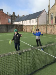 Brothers Murray and Millar MacKay testing their racquet during a flurry of snow.