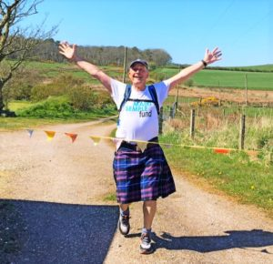 Southend's Andrew Rathey received a raucous welcome from his family as he crossed a bunting finish line after completing a two-day, 25-mile trek to raise vital funds for the Mairi Semple Cancer Fund.