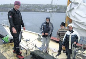 In 2011: Diver Robert Lamont, far left, removed the damaged rudder from Sceptre when she was safely back at Campbeltown Harbour. Also pictured, from left: skipper Tom Smith, Neil Blair and Roger Finbow.