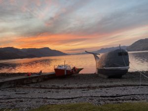 The famous whale boat which 'basks' on the shore of Ardintigh Bay on the banks of Loch Nevis. NO F25 Ardintigh Sunset