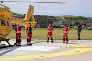 The crew of a Scottish Ambulance Service helicopter touched down for the ceremony.
