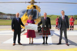 From left: Simon Jones from the HELP Appeal which funded the helipad; Robert Black's wife Catherine; Eric Spence, manager of SKDT, which is responsible for the ongoing operation and maintenance of the helipad; and Stuart McLellan, who spearheaded the project. Photograph: Kenny Craig.