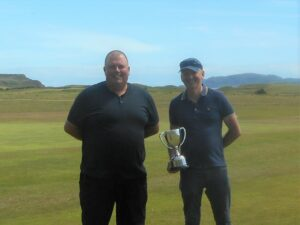 Captain Graeme McLennan presenting George MacMillan with the Championship Trophy.