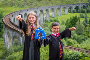 Harry Potter fans Amy, 11, and seven-year-old Ross McCreadie with their water bottles which can now be refilled at the top up tap at Glenfinnan. Photograph: Chris Watt/chriswattphotography. NO F29 Glenfinnan tap inside
