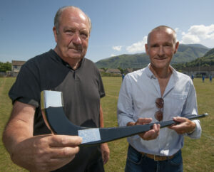 Richard Gall (left) of Fort William Shinty Club presents an engraved black caman to Sandy Slater in recognition of the work he did in securing funding for Fraser's Field. Photograph: Iain Ferguson, alba.photos NO F31 Frasers Field 03