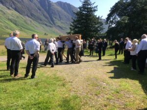 Members of Glencoe Mountain Rescue Team carry his coffin from his home in the village. NO F31 Walter Elliot 01