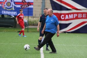 Dick McFadzean kicking off the match. Photograph: Kenny Craig.