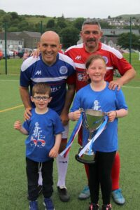 Alex Rae and Charlie Miller with Jimmy Taylor's grandchildren Keelan and Taylor Black. Photograph: Kenny Craig.