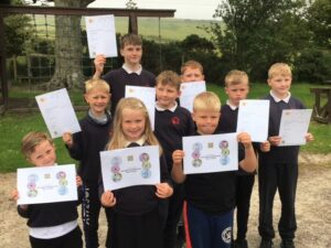 Rhunahaorine Primary School's children with their John Muir Trust Discovery Award and participation certificates.