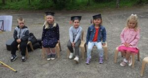 The nursery children, accompanied by Mandy Beveridge on guitar, ended the ceremony with a goodbye song.