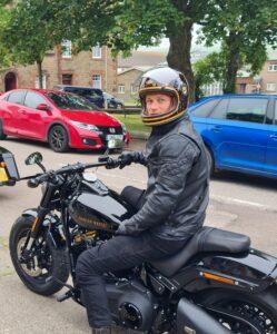 Outlander star Sam Heughan rode into Campbeltown on a custom Harley Davidson motorcycle.