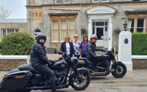 Sam Heughan and a friend outside Campbeltown's Ardshiel Hotel with staff Amanda Grant, Flora Grant and Marion MacKinnon.