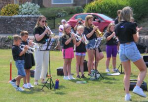More experienced band members performed using a variety of brass instruments.