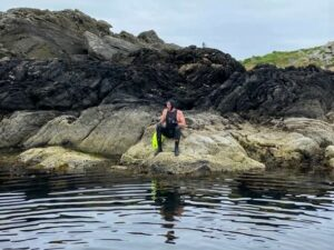 Eddie 'clambered' on to some rocks after reaching Gigha in less than an hour.