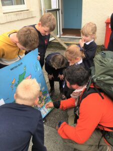 Chris showed the children his route on a map of the British Isles.