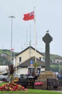 The Red Ensign, the flag of British merchant ships, was flown from the top of Campbeltown's Old Quay in honour of Merchant Navy Day.