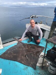 Ricky Scott with one of the record-breaking skate landed on Seadog.